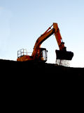 Soil falling from dozer bucket Stock Image