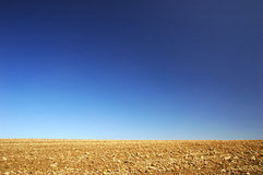 Soil field. In spring with deep blue sky above Stock Images
