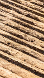 Soil floor and truck tire Royalty Free Stock Images