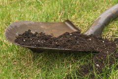 Soil on Garden Spade Stock Image