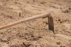 Soil with a hoe Stock Photos