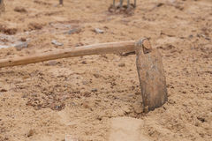 Soil with a hoe. At construction site Stock Image