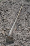 Soil with a hoe at construction site.  Royalty Free Stock Images