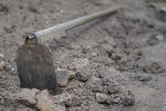 Soil with a hoe at construction site.  Stock Photo