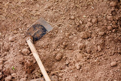 Soil with Hoe Stock Photography