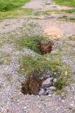 Soil hole on road Stock Photo