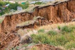 Soil landslide on slopes after earthquake. Royalty Free Stock Image