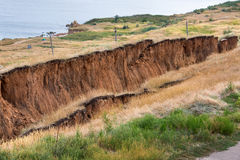 Soil landslide on slopes after earthquake. Stock Image