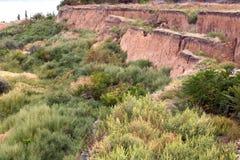 Soil landslide on slopes after earthquake. Stock Photo