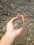 Soil on man hand Royalty Free Stock Photography