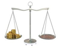 Soil and money on the scales Stock Photos