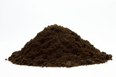Soil in a pile on the white background Royalty Free Stock Photos