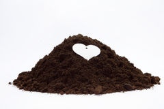 Soil in a pile on the white background Royalty Free Stock Photo