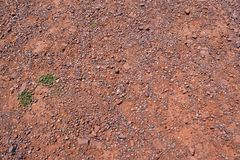 Soil of red clay and red rock near the Atlas Mountains in Morocco royalty free stock photo
