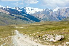 Soil road in high mountains. Tien Shan Stock Images