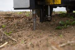 Soil Sampling. Automated probe for soil samples taking sample with soil probe sampler. Environmental protection, organic soil. Certification, research royalty free stock photos
