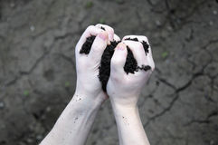 Soil seeps through your fingers Stock Image