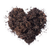 Soil shaped into a heart symbol isolated on white background Royalty Free Stock Photos