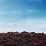 Soil on sky background Stock Photo