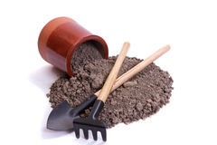 Soil, tools and ceramic pot Stock Image
