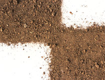 Soil on white background Stock Photos