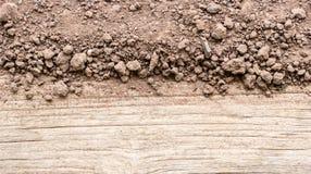 Soil on wood. Stock Photos