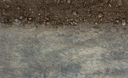 Soil on wood background. Royalty Free Stock Photos
