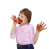 Soiled chocolate girl Royalty Free Stock Image