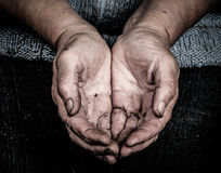 Soiled hands of elderly women Royalty Free Stock Images