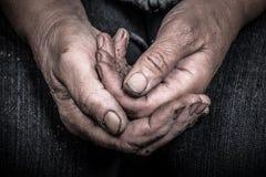 Soiled hands of elderly women Royalty Free Stock Image