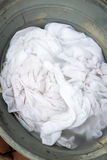 Soiled laundry in an old bucket Stock Photography