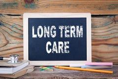 Soin à long terme Santés et sécurité Fond de panneau de craie Images stock