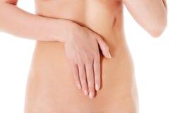 Soin de corps, concept de régime de grossesse, femme tenant des mains sur l'estomac Photos libres de droits
