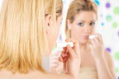 Soin de lèvres Photographie stock libre de droits