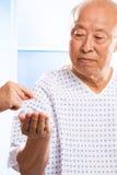 Soins de santé asiatiques aînés Photo stock