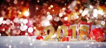 soirée du Nouveau an 2018 avec le rendu de babioles et de cadeaux 3D de Noël Photo libre de droits
