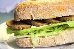 Sojabohnenölburger ciabatta Stockfotografie