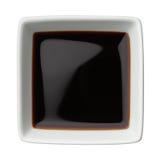 Sojasaus in een vierkante geïsoleerde kom royalty-vrije stock foto