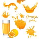 Soków pomarańczowych pluśnięcia Zdjęcia Royalty Free