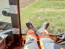 The worker rests his legs during a break at work stock images