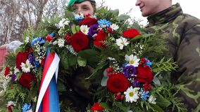 Sokolovo, Kharkiv region, Ukraine - 9 March 2018: Czech soldiers with flowers in his hands. Anniversary of the battle. Near the village of Sokolovo. outdoors stock video