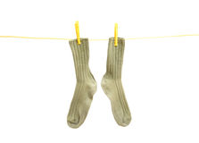 Soks on clothes line. Green pair of soks on clothes line stock image