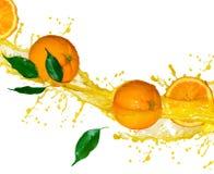 soku pomarańcze splashng Zdjęcia Royalty Free
