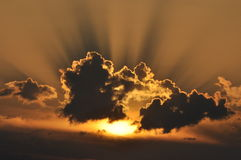 Sol bak molnen, Arkivfoton