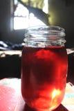 Sol de vidro vermelho da água Imagem de Stock Royalty Free
