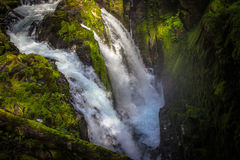 Sol Duc Falls in Olympic National Park. Sol Duc Falls waterfall in the middle of a lush temperate rainforest the Sol Duc Valley in Olympic National Park Stock Photos
