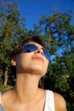 Sol en cara de las muchachas Imagen de archivo libre de regalías