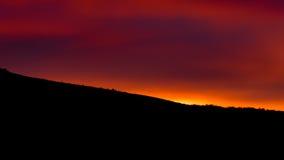 Sol encarnado da manhã Imagem de Stock