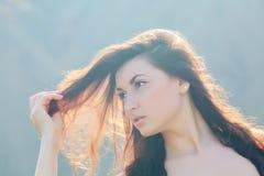 Sol i hennes hår Royaltyfria Bilder