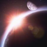 Sol naciente sobre la tierra del planeta Foto de archivo